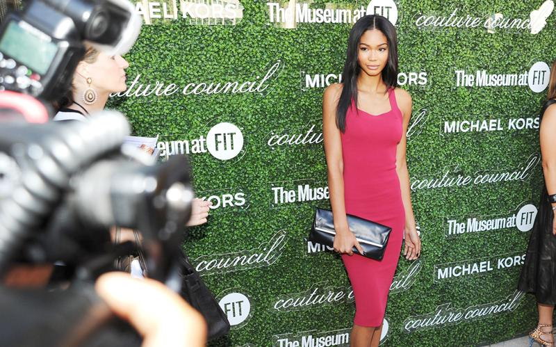 Model Chanel Iman poses on the red carpet at the Couture Council luncheon honoring designer Michael Kors (2013). Photography by Getty Images among others.