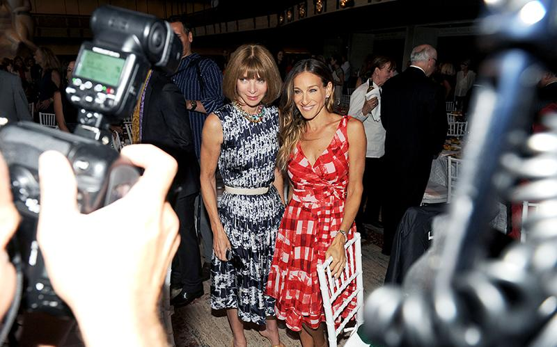 Vogue editor Anna Wintour and actress Sarah Jessica Parker pose for photographers at the Couture Council luncheon honoring designer Oscar de la Renta (2012). Photographer and socialite Patrick McMullan captured the event.