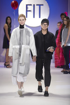 Peter Do on runway with model