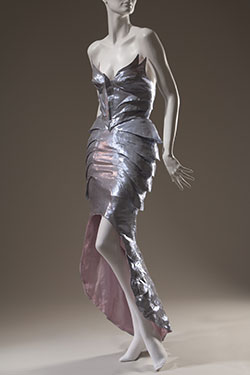 purple metallic dress with form fitting winged bustier and fishtail train