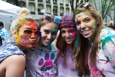 students with colored powder on their faces