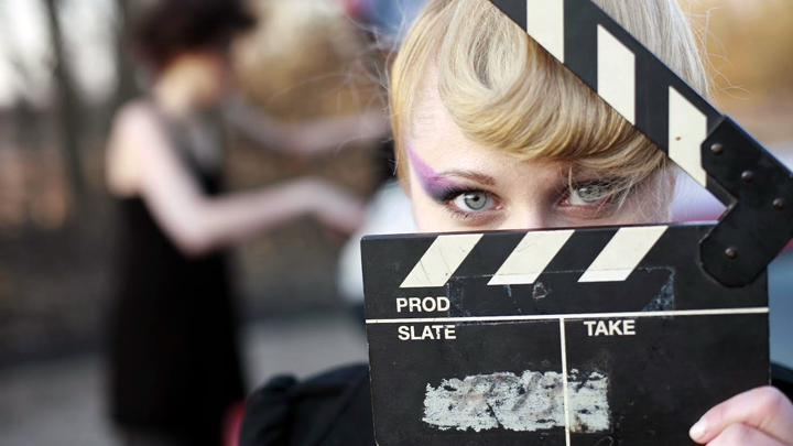 woman with film clapperboard