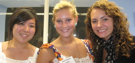 three students at an honors program event