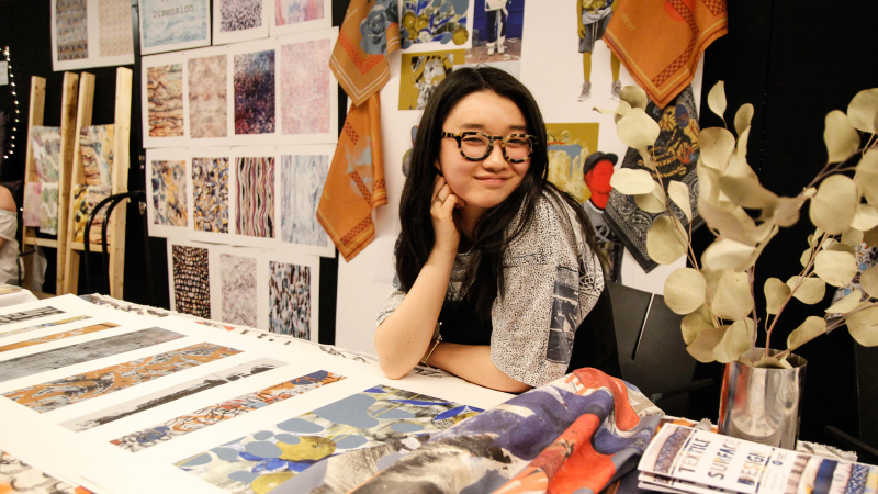 student exhibiting fabrics and mood board