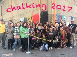 students standing in front of the 2017 chalk portraits