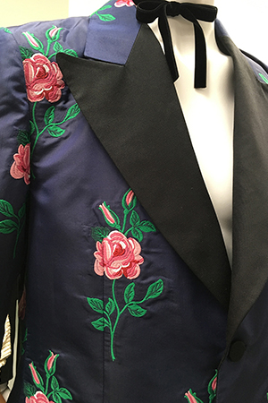 dark blue man's suit jacket embroidered with pink roses