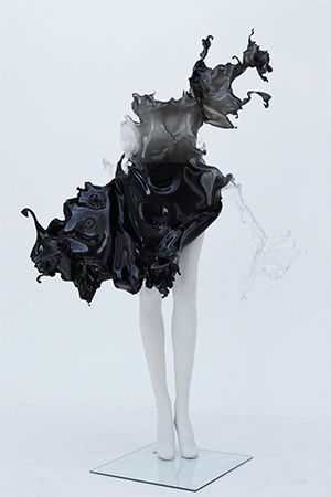 Hand sculpted black to grey acrylic dress in the shape and form of water