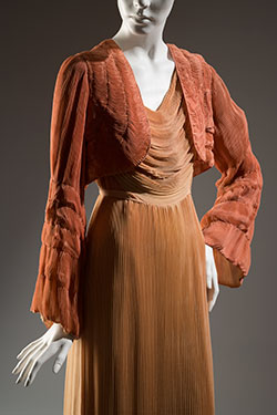 dustry orange owl draped and pleated dress