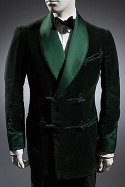 green jacket with cashmere trousers and black bowtie