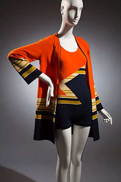 orange and navy swimsuit with off-white and green large zig-zag and strip patterns with matching jacket