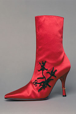 red silk satin boot with pointed toe and stiletto heel with gold ring and decorative black passementerie in Chinese style on outside