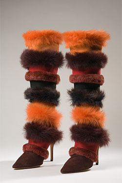 alternating red, orange, and burgundy suede and long-haired pressed shearling stiletto boots