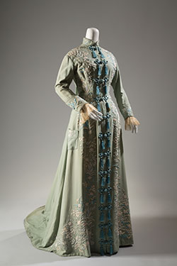"""light green morning robe with symmetrical floral embroidery in shades of blue and white; """"Chinese"""" styling with stand collar and multiple tassels and CF frogs"""