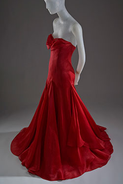 layered red silk organza with strapless petal neckline and floor length skirt
