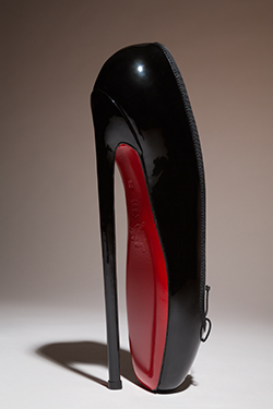 "Christian Louboutin, black patent leather ""Fetish Ballerine"" shoes, 2014. The Museum at FIT, Gift of Christian Louboutin. © The Museum at FIT"