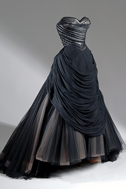 Charles James, black silk and synthetic net and satin evening dress, 1954. The Museum at FIT, Gift of Robert Wells in memory of Lisa Kirk. © The Museum at FIT