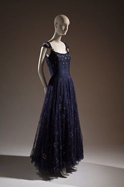 "Gabrielle ""Coco"" Chanel, ""Etoiles"" navy blue tulle and sequin evening dress 1937. Lent by Beverley Birks. © The Museum at FIT"