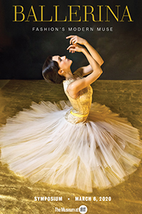 Ballerina sitting in graceful pose in a gold and white tulle ensemble