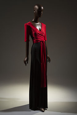 red and black dress with deep v-neck, short sleeves, and wrap and tie extensions