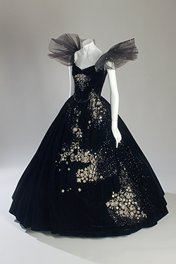 black silk velvet dress with black tulle ruffles at shoulders and rhinestones and sequins on front