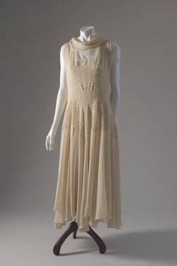 long sleeveless dress in ivory, georgette shapped through torso with pintucked design of roses