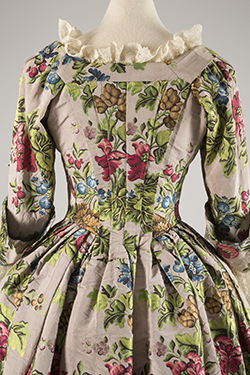 robe a l'anglaise gown with brightly colored large floral patterns in shades of pink, green, brown, and blue