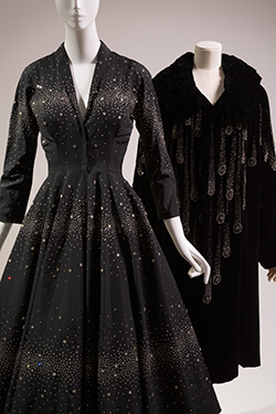 (R) Saks Fifth Avenue, cocktail dress, Fall 1953, USA, Gift of Sophie Gimbel. 75.69.3. (L) Evening coat, circa 1920, France, Gift of John J. Sasek. 81.88.1