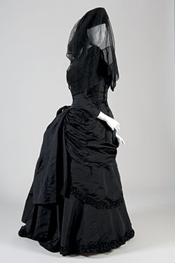 Victorian Mourning Dress, c. 1880, black silk and netting. Lent by Evan Michelson. Photo by Irving Solero.