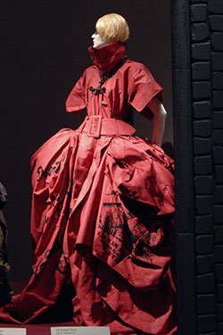 Christian Dior (John Galliano), evening dress and cross necklace, red coated silk, black ink, and metal. Spring 2006, France. Lent by Christian Dior, Paris. Photo by Irving Solero.