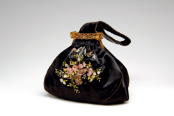 small black handbag with floral embroidery