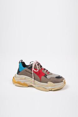 man's taupe, red, and blue distressed lace-up sneakers with multi-surface stacked rubber soles and embroidered size and logo