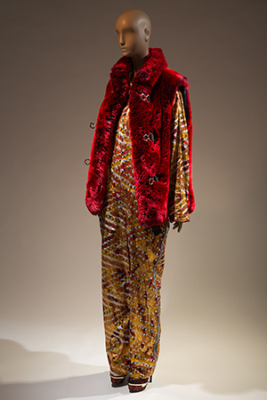 XULY.Bët ensemble of a multi-colored African cotton print jumpsuit with a red faux fur vest