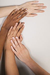 arms and hands reflective of different races embracing each other