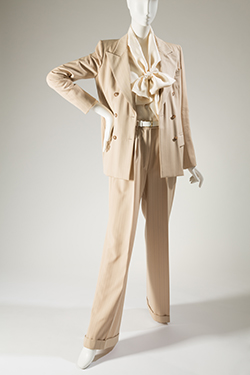 beige pantsuit with light and dark gray pinstripe