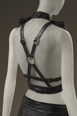 back of the black leather bondage ruffle top showing straps come together at center