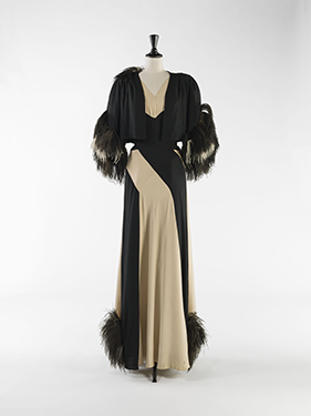 Nina Ricci, evening ensemble (dress and bolero),             wool and silk muslin in cream and black, ostrich feathers, circa 1937. © Julien Vidal/Galliera/Roger-Viollet.