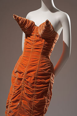Jean Paul Gaultier, shirred orange velvet dress with cone bust, 1984, France. Museum purchase, P92.8.1.
