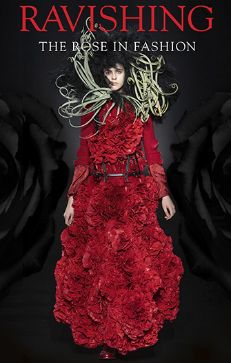model in a full length red dress that has surface ruffles that appear as roses