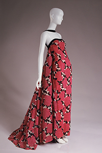 red, black, and white Strapless evening dress with long rectangular stole.