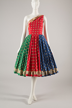 red, green, and blue one-shoulder dress with spaced print in yellow, red, blue, and black