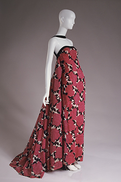 strapless evening dress and long rectangular stole with red and pink rose design on black and white leaf pattern, black velvet trim, and train