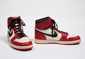 red and white high top sneakers with black nike swoosh