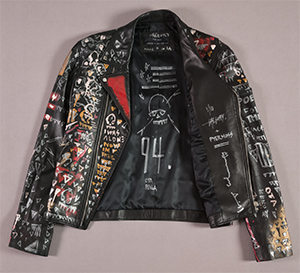 black jacket with words painted in red, yellow, and white