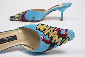 blue kitten heels with beaded work that reads whaam