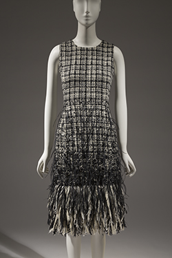 black and white sleeveless dress with black feathers at the bottom