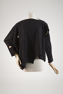 long sleeve black shirt with cut outs along arms