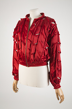 red long sleeve jackets with slits along arms and front and back of jacket